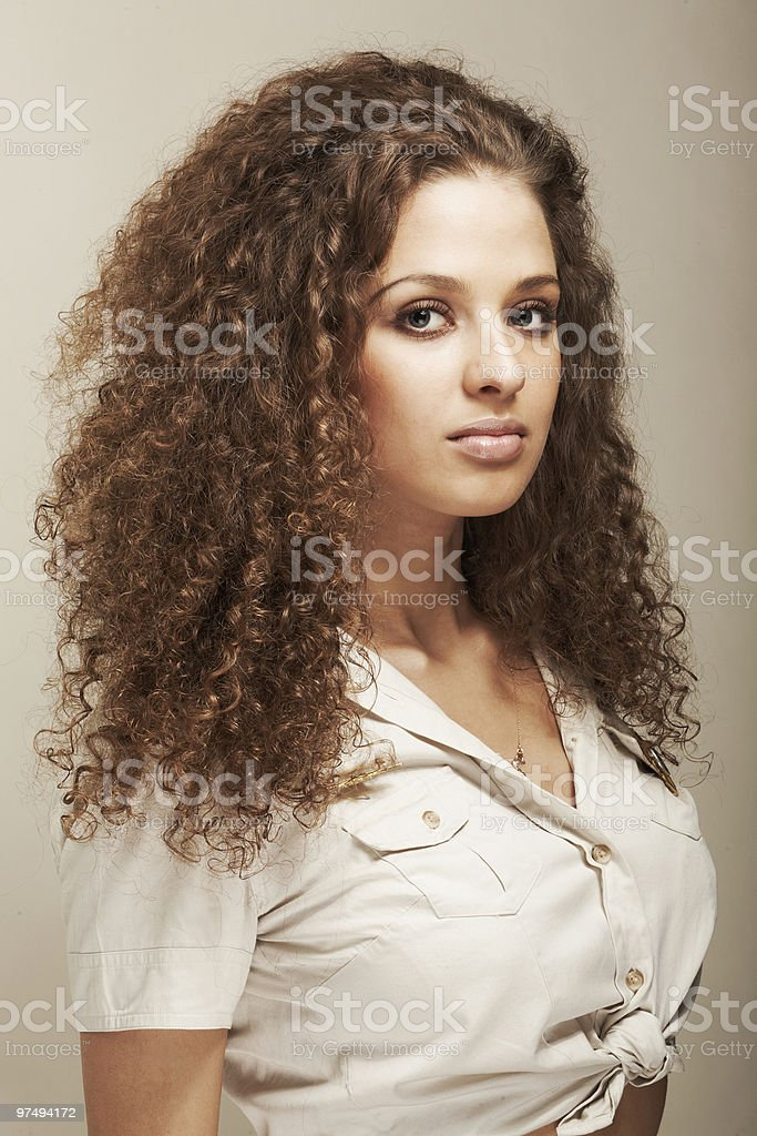 Portrait of sexy woman with  long curly hair royalty-free stock photo