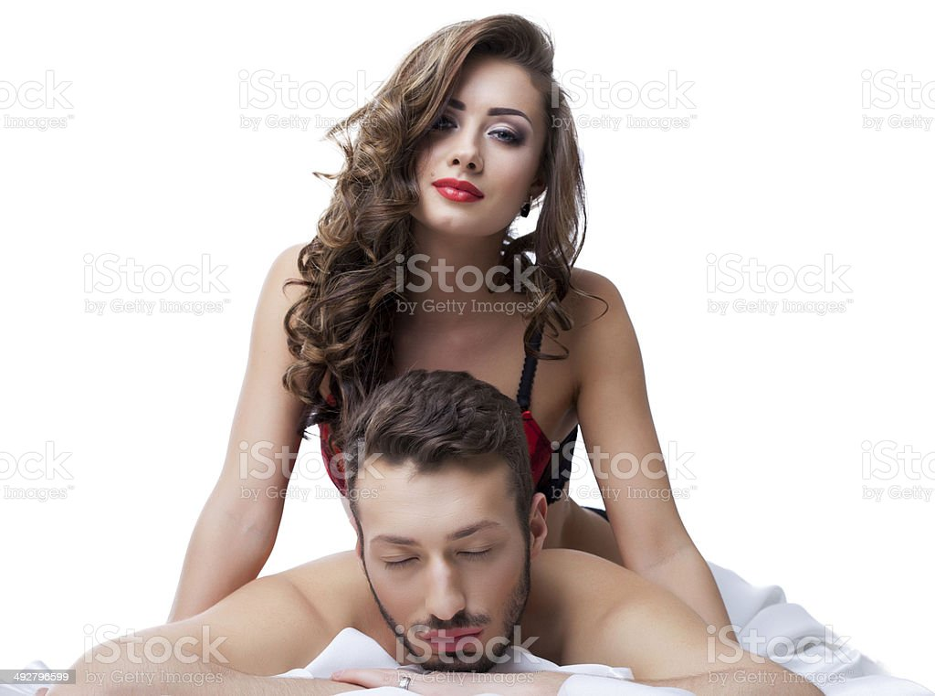 Portrait of sexy young lovers posing in studio stock photo