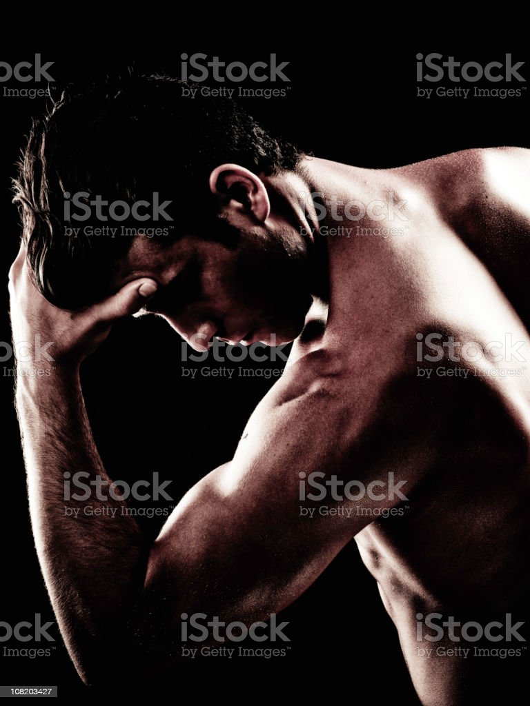 Portrait of Shirtless Young Man Posing, Isolated on Black royalty-free stock photo