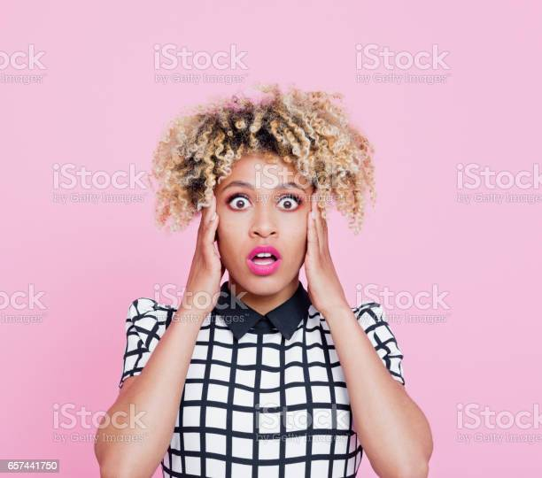 Portrait Of Shocked Afro American Young Woman Stock Photo - Download Image Now