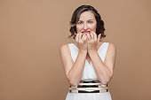 istock Portrait of shocked and worried adult woman 999962480