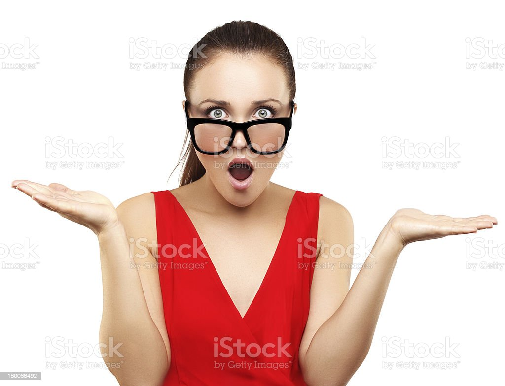 Portrait of shocked businesswoman standing against white background and shrugging. royalty-free stock photo