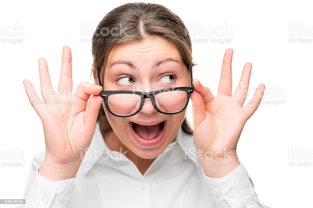 portrait of shocked businesswoman with glasses looking aside in stock photo