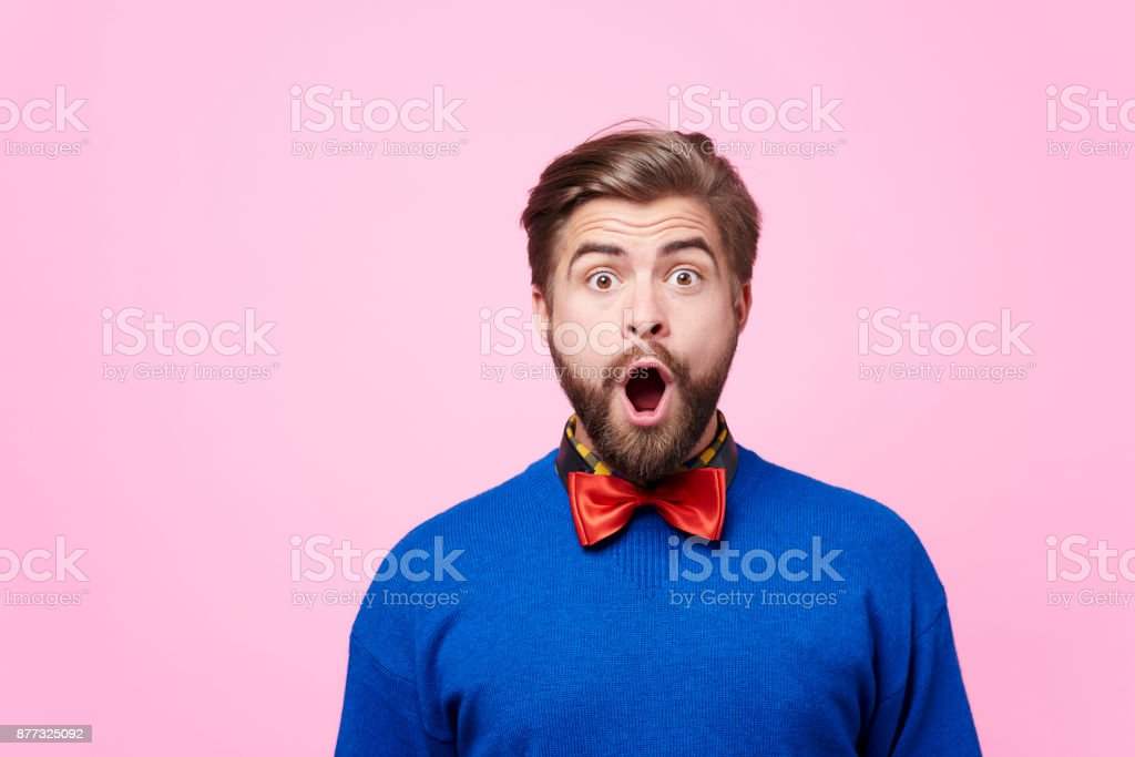 Portrait of shocked man at studio shot stock photo