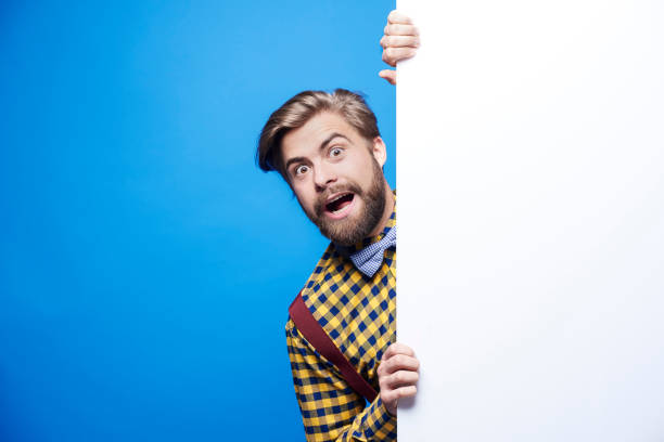 Portrait of shocked man peeking Portrait of shocked man peeking hide and seek stock pictures, royalty-free photos & images