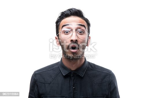 istock Portrait of shocking handsome man looking at camera 962315564