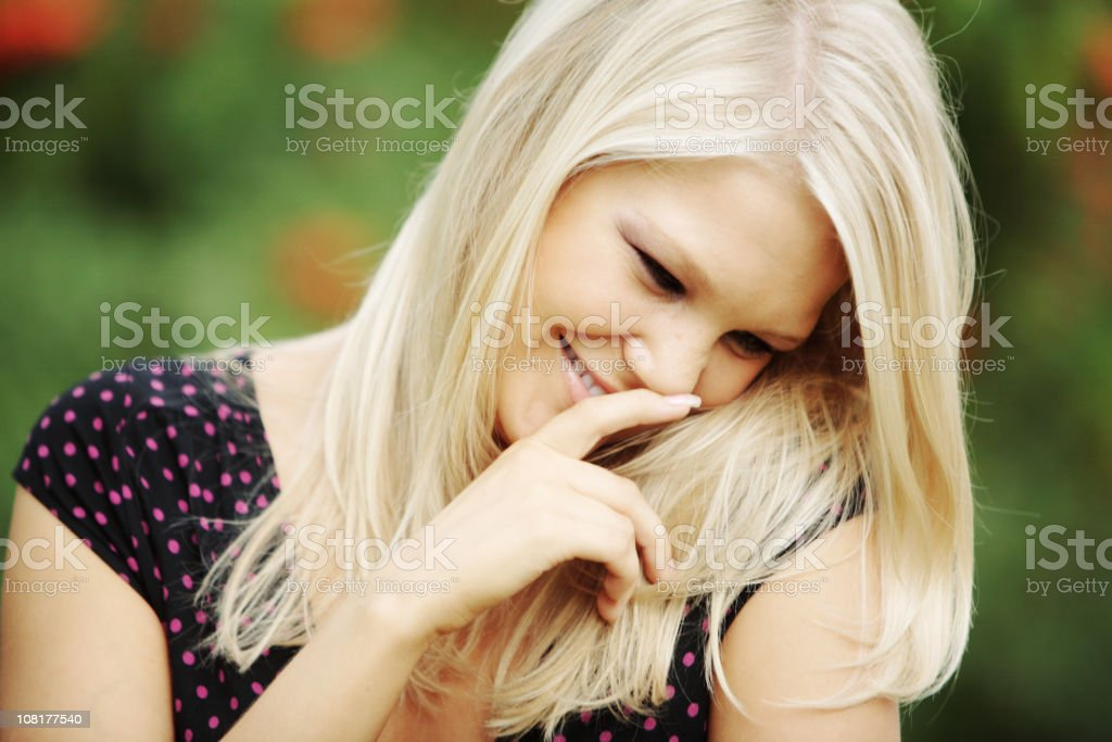 Portrait of Shy Young Woman Laughing royalty-free stock photo