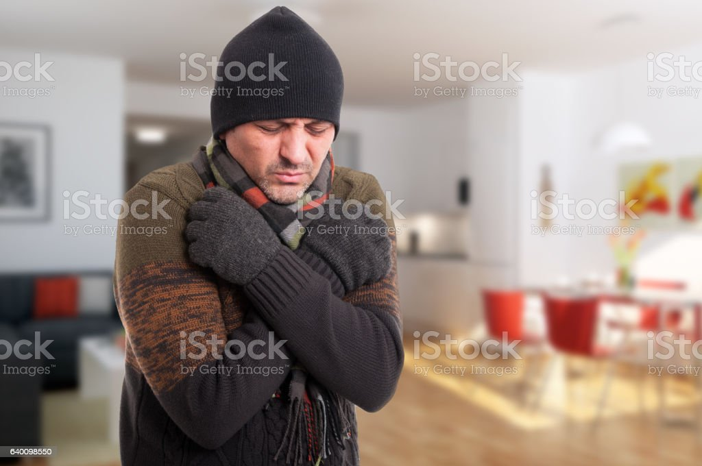 Portrait of sick man shivering from cold stock photo