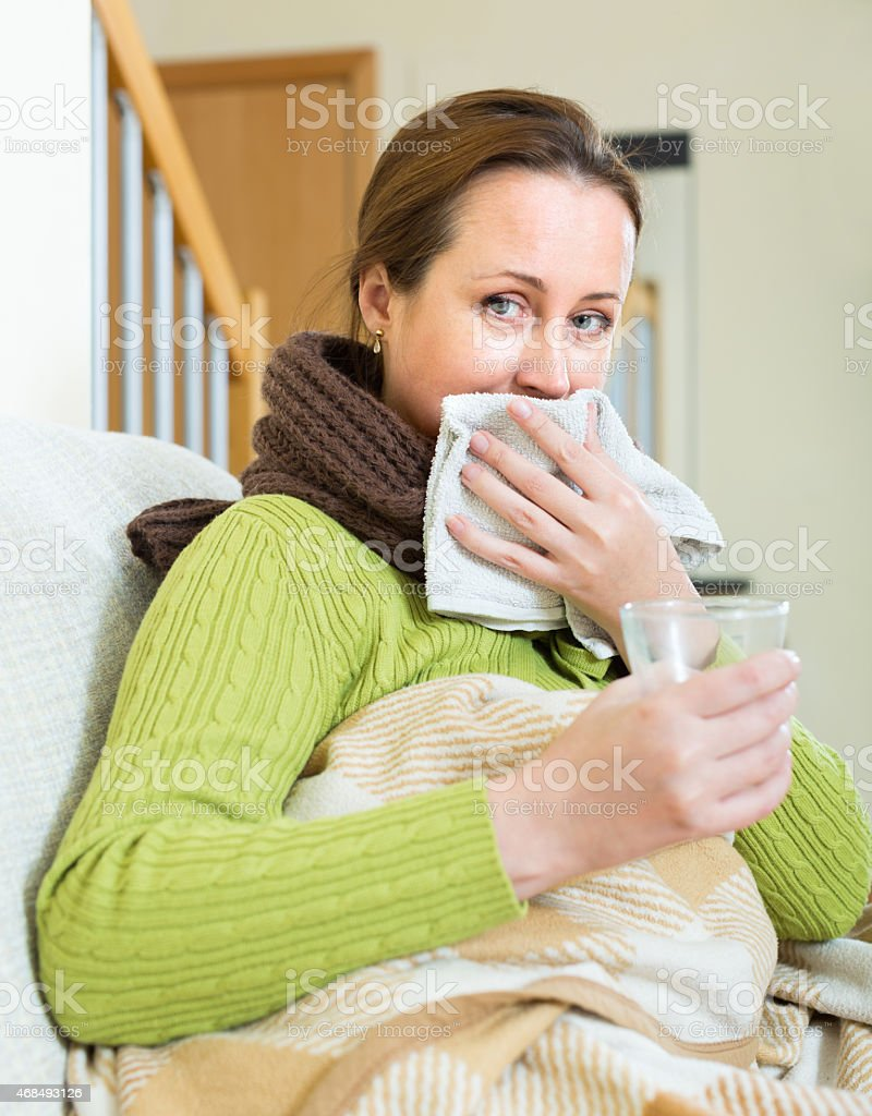 Portrait of sick woman at home stock photo