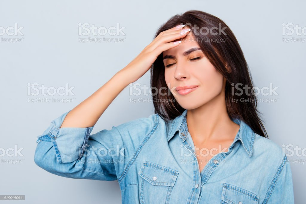 Portrait of sick young woman having strong headache stock photo