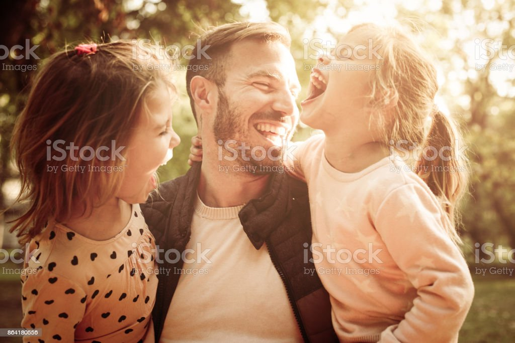 Portrait of single father with his daughter in park. royalty-free stock photo