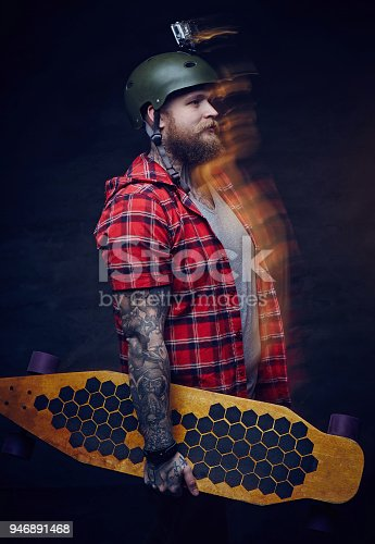 istock Portrait of skateboarded with go pro on his helmet. 946891468