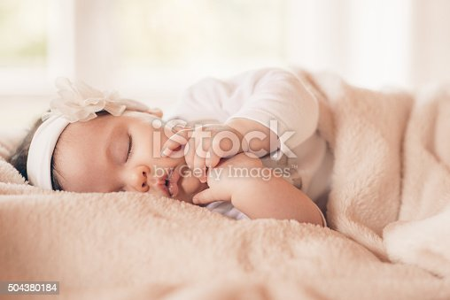 istock Portrait of sleeping baby in home and window is behaind 504380184