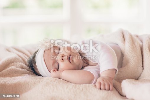 istock Portrait of sleeping baby 504380478