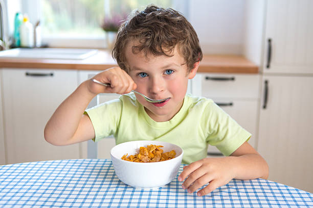 Best Kids Eating Cereal Stock Photos, Pictures & Royalty ...