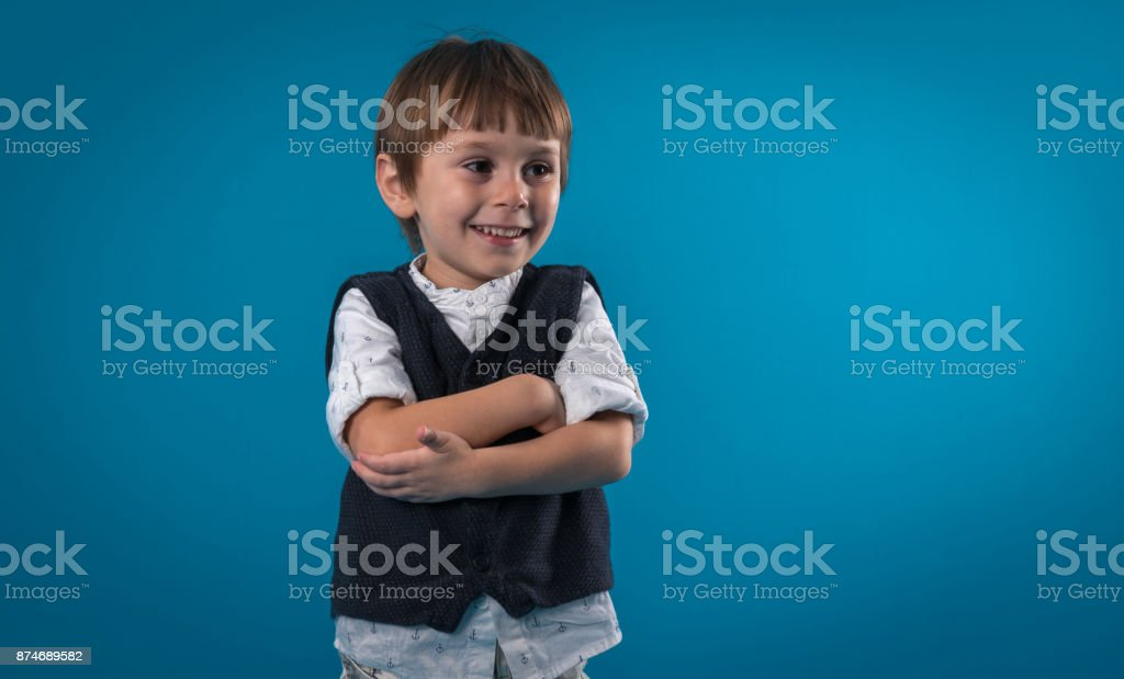 Portrait of small boy over colored background stock photo