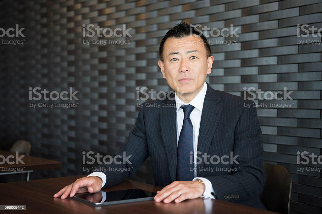 Portrait of smart mature Japanese businessman – Foto
