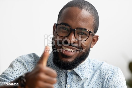 istock Portrait of smart smiling African American businessman gesturing thumbs up 1156269833