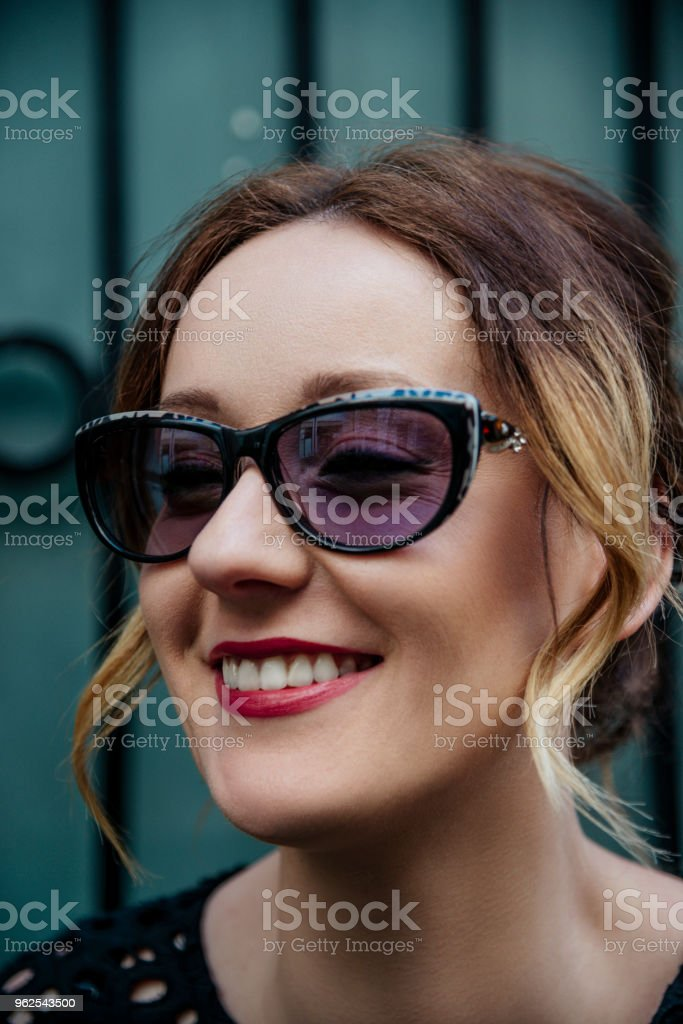 Portrait of smile stylish woman in sunglasses and black elegant shirt - Royalty-free Adult Stock Photo