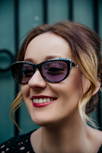 Portrait Of Smile Stylish Woman In Sunglasses And Black Elegant Shirt Stock Photo - Download Image Now