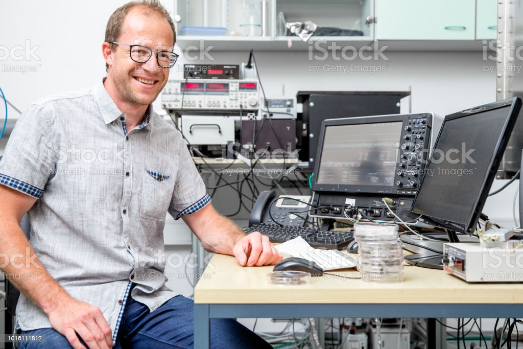 Portrait of Smiling Adult Man Researcher in Laboratory stock photo