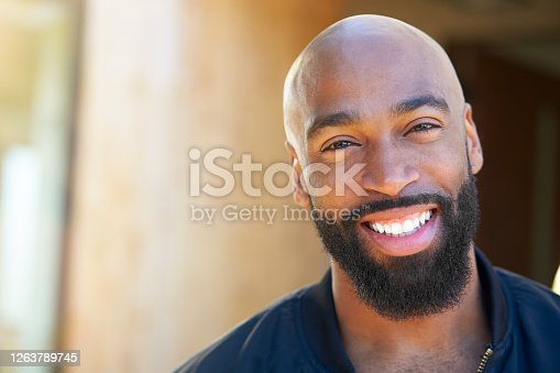 istock Portrait Of Smiling African American Man Outdoors In Garden At Home 1263789745