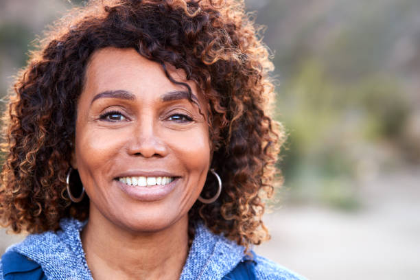 Portrait Of Smiling African American Senior Woman Outdoors In Countryside stock photo