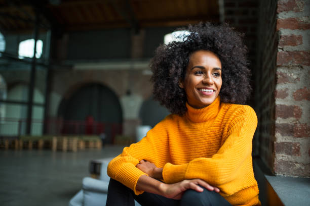 Portrait of smiling African American woman Portrait of smiling African American woman looking trow the window looking away stock pictures, royalty-free photos & images