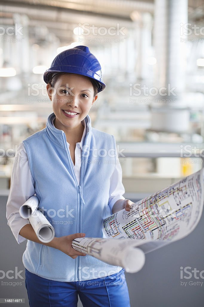 Portrait of smiling architect with blueprints stock photo
