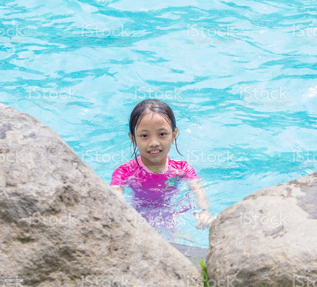 Portrait of smiling Asian Girl (Kid) at Pool Side stock photo