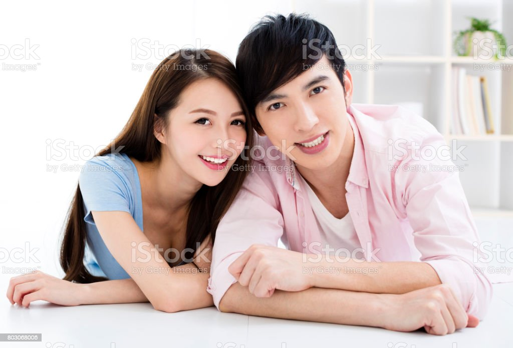 Portrait of  smiling asian young couple stock photo
