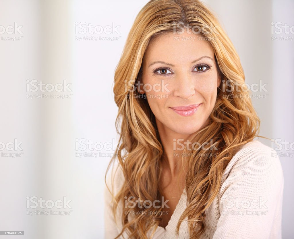 Portrait of smiling attractive blond woman. stock photo