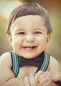 Portrait of smiling baby boy with bow tie.