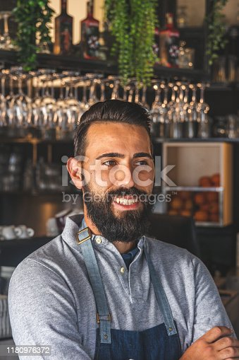1003493404istockphoto Portrait of smiling bearded cafeteria owner 1180976372