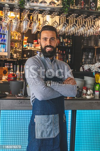 1003493404istockphoto Portrait of smiling bearded cafeteria owner 1180976373