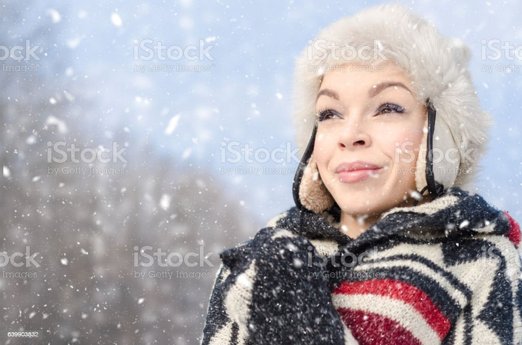 Portrait of smiling beautiful girls standing outside in the cold stock photo