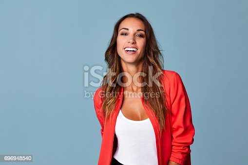 istock Portrait of smiling beautiful woman 696948540