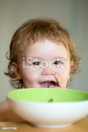 istock Portrait of smiling boy eating 484477436