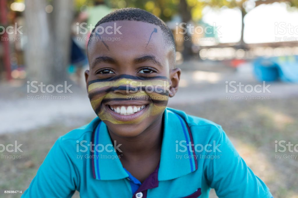 Portrait of smiling boy with face paint stock photo