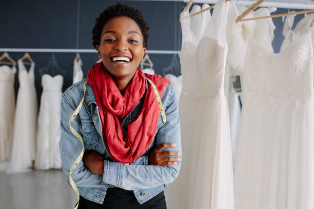 Portrait of smiling bridal store owner stock photo