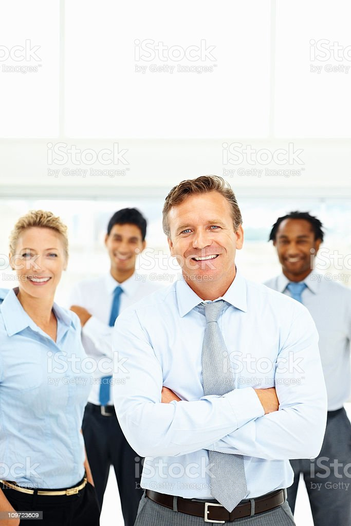 Portrait of smiling business executives standing together royalty-free stock photo
