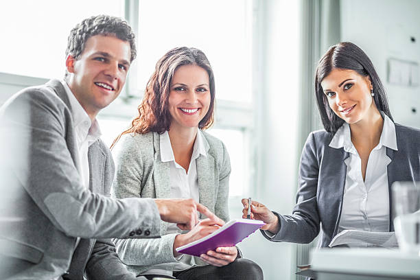 Portrait of smiling business people discussing in office – Foto