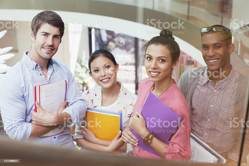 Portrait of smiling business people with folders royalty-free stock photo