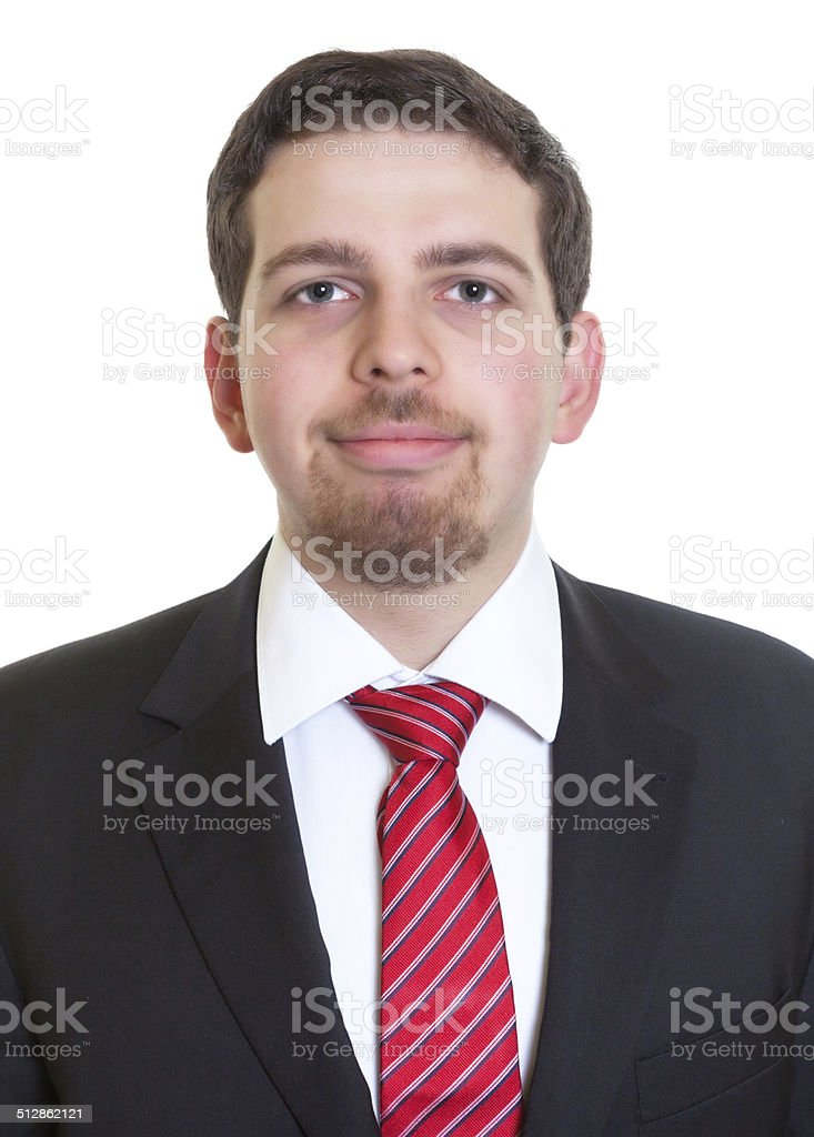 Portrait of smiling businessman in black suit stock photo