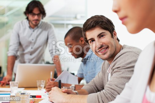 istock Portrait of smiling businessman in meeting 137087227