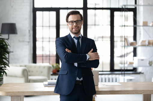 825082848 istock photo Portrait of smiling businessman posing in modern office 1248226411