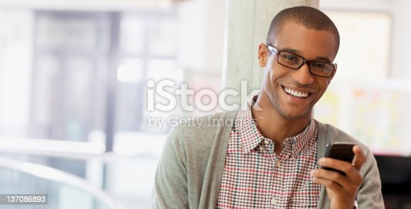 istock Portrait of smiling businessman with cell phone 137086893