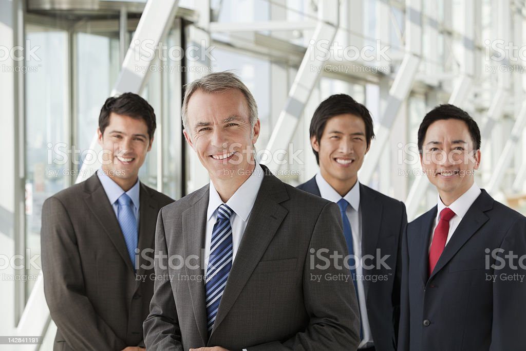 Portrait of smiling businessmen stock photo