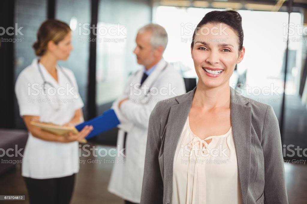 Portrait of smiling businesswoman in hospital stock photo