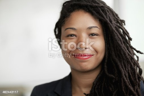 istock Portrait of smiling businesswoman with dreadlocks, head and shoulders 462443117